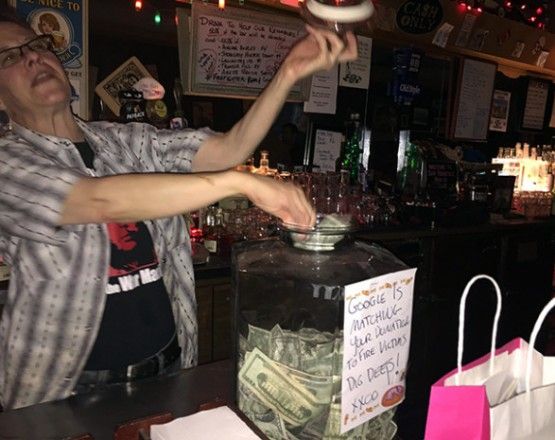 Lisa worked the bar and helped add bills to the cash donation jar.